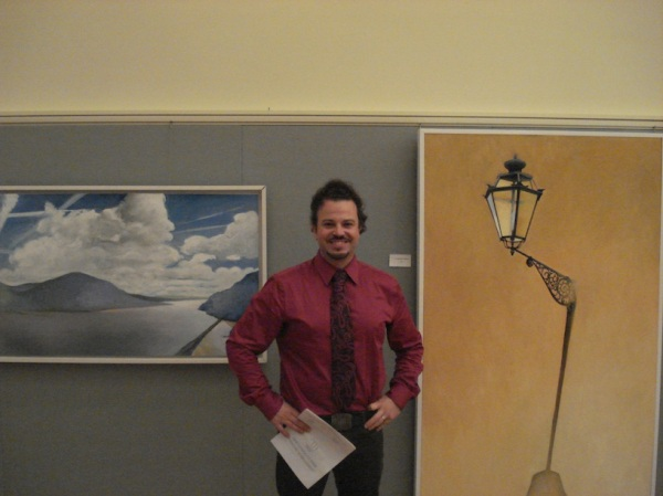 Martin Paddack with two of his paintings, Light and Time on the Hudson, (left) and Teardrop, Florence (right)
