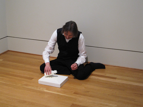 Director of the Center for the Study of Modern Art Klaus Ottmann pours milk onto Wolfgang Laib's Milkstone. Photo by Sarah Osborne Bender.