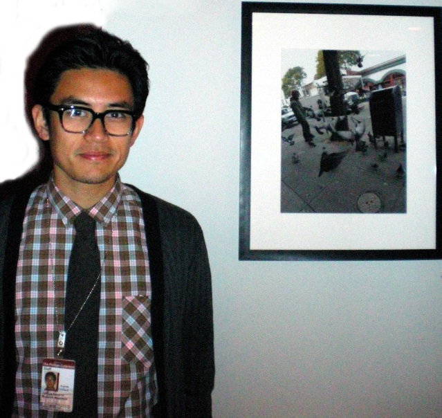 "Joshua Navarro with his digital photograph, ""Snacktime."" Photo by Claire Norman"
