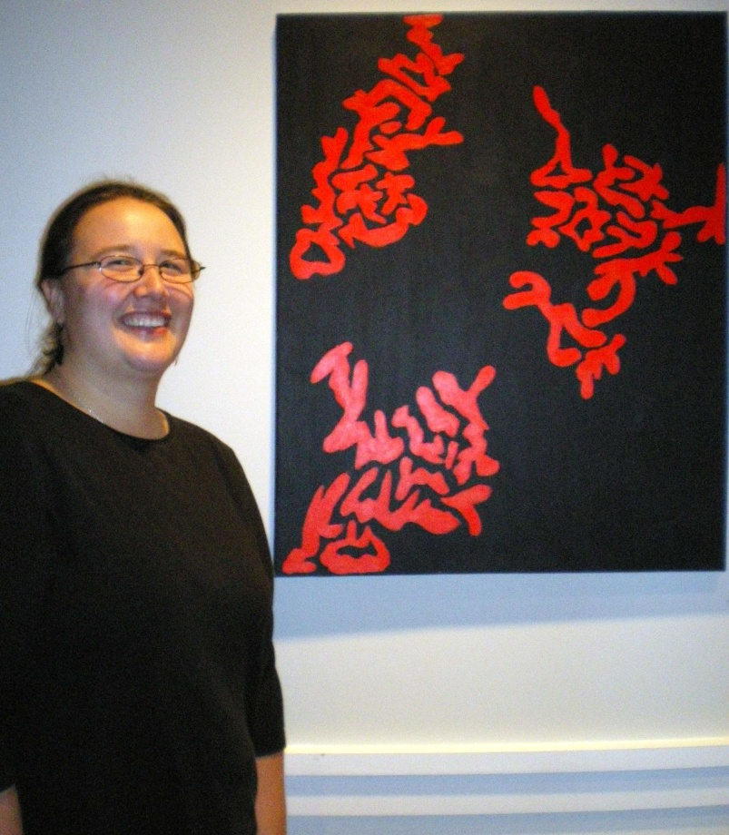 """Meghan Schindler with her acrylic painting, """"Doodle #2."""" Photo by Claire Norman"""