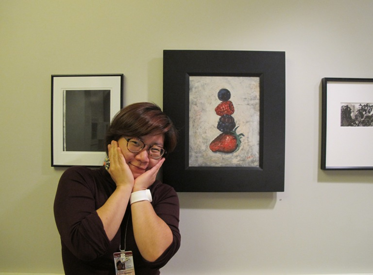 "Sue Ahn with her mixed media painting, ""Berries."" Photo by Sarah Osborne Bender"