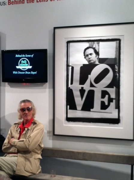 "Robert Indiana next to a photo with his ""LOVE"" sculpture. Photo by Amanda Jiron-Murphy."